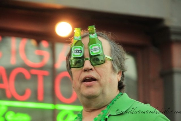 Beer bottle glasses at St Patricks Day parade, New Orleans